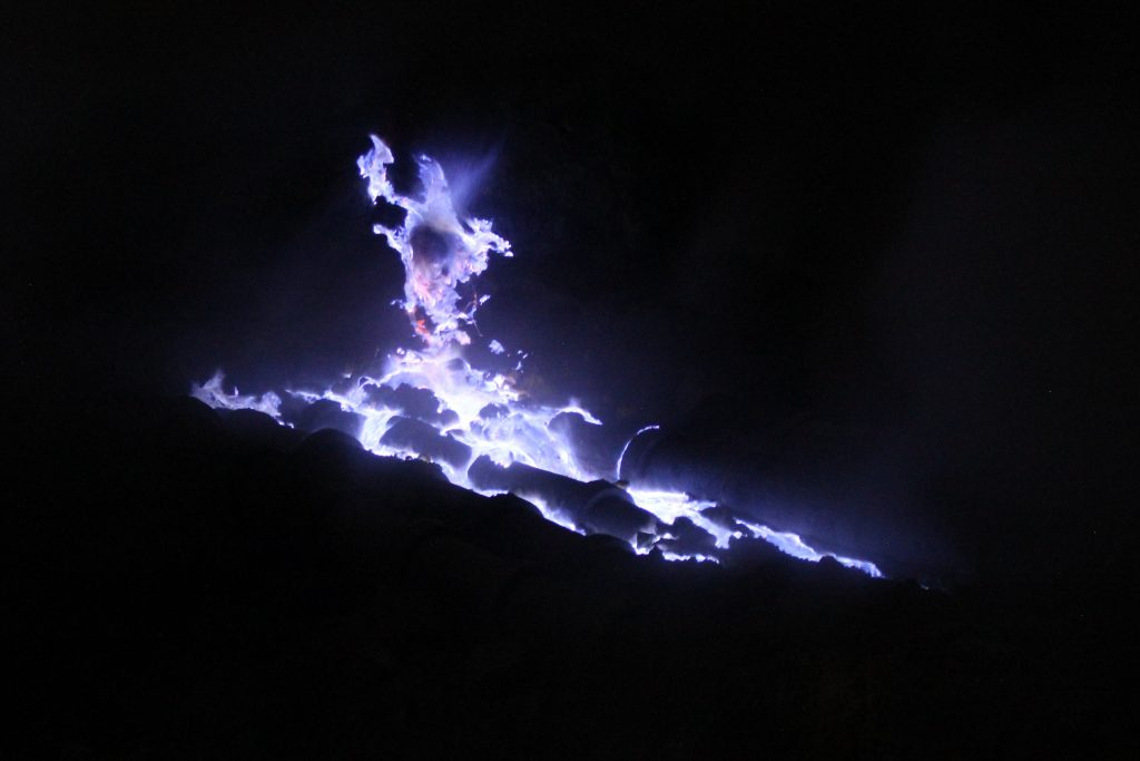 blue fire in the crater of vulcano Ijen