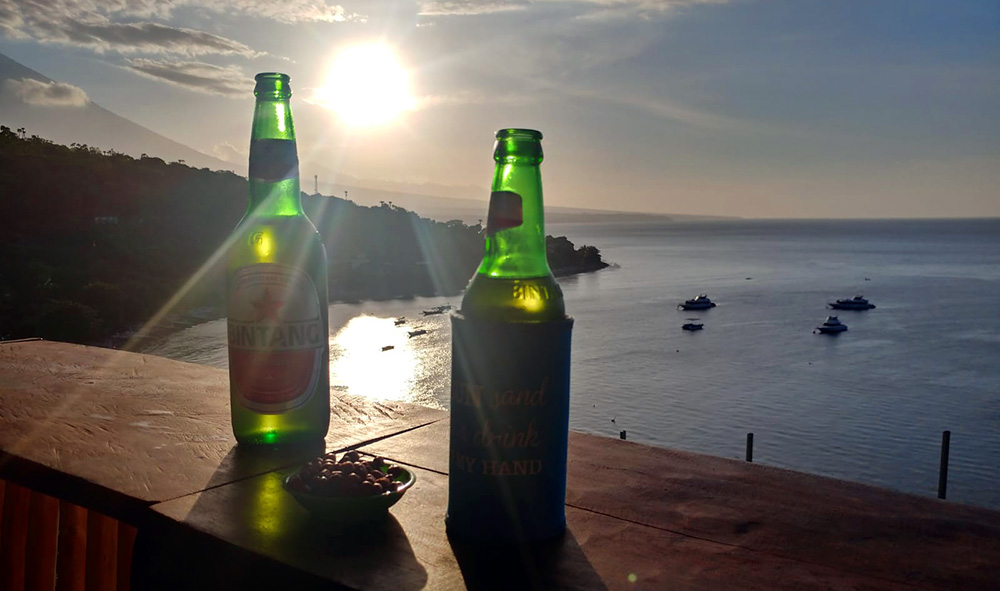 sunset beer at the bay of Jemuluk